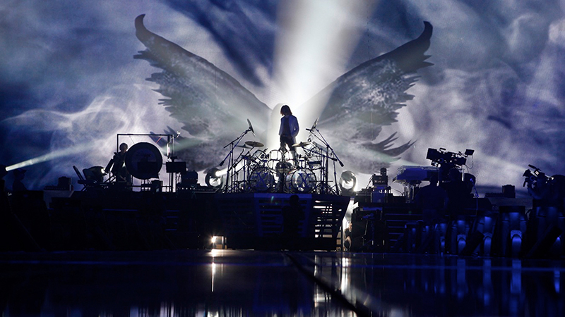 Yoshiki looks out over his drum kit during a rehearsal for X Japan's Madison Square Garden concert in Drafthouse Films' We Are X. Courtesy of Drafthouse Films.